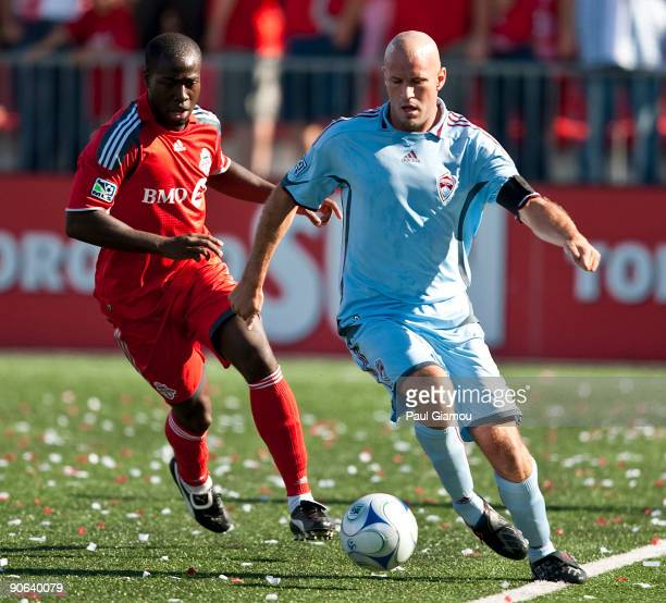 Defender Nana Attakora-Gyan of the Toronto FC chases for the ball with forward Connor Casey of the Colorado Rapids during the match at BMO Field on...