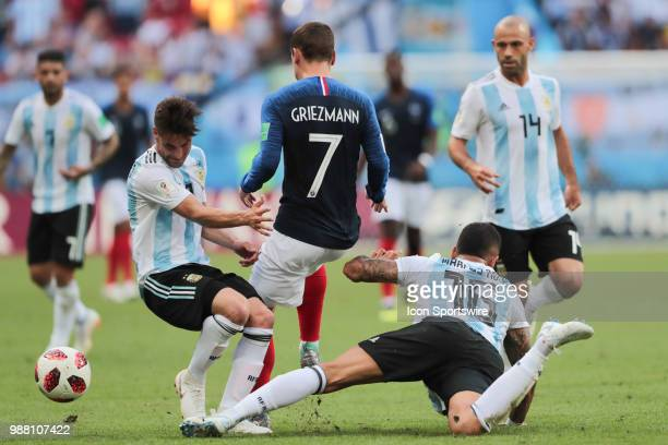 Defender Nicolas Tagliafico of Argetina National team forward Antoine Griezmann of France National team and defender Marcos Rojo of Argetina National...