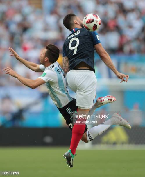 Defender Nicolas Tagliafico of Argetina National team in action with forward Olivier Giroud of France National team during the round of 16 match...