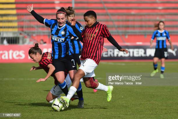 Defender of AC Milan Women Linda Tucceri Cimini competes for the ball with Gloria Marinelli of FC Internazionale Women and Jane Refiloe of AC Milan...
