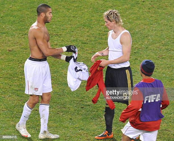 US defender Oguchi Onyewu and Spanish forward Fernando Torres exchange their jerseys after the Fifa Confederations Cup semifinal football match Spain...