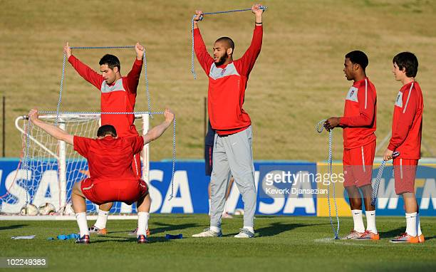 Defender Oguchi Onyewu of US national football team warms up with teammates during training session at Pilditch Stadium on June 20 2010 in Pretoria...