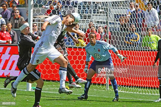 Defender Omar Gonzalez of the Los Angeles Galaxy attempts a header against DC United during their MLS game at Home Depot Center on March 22 2009 in...