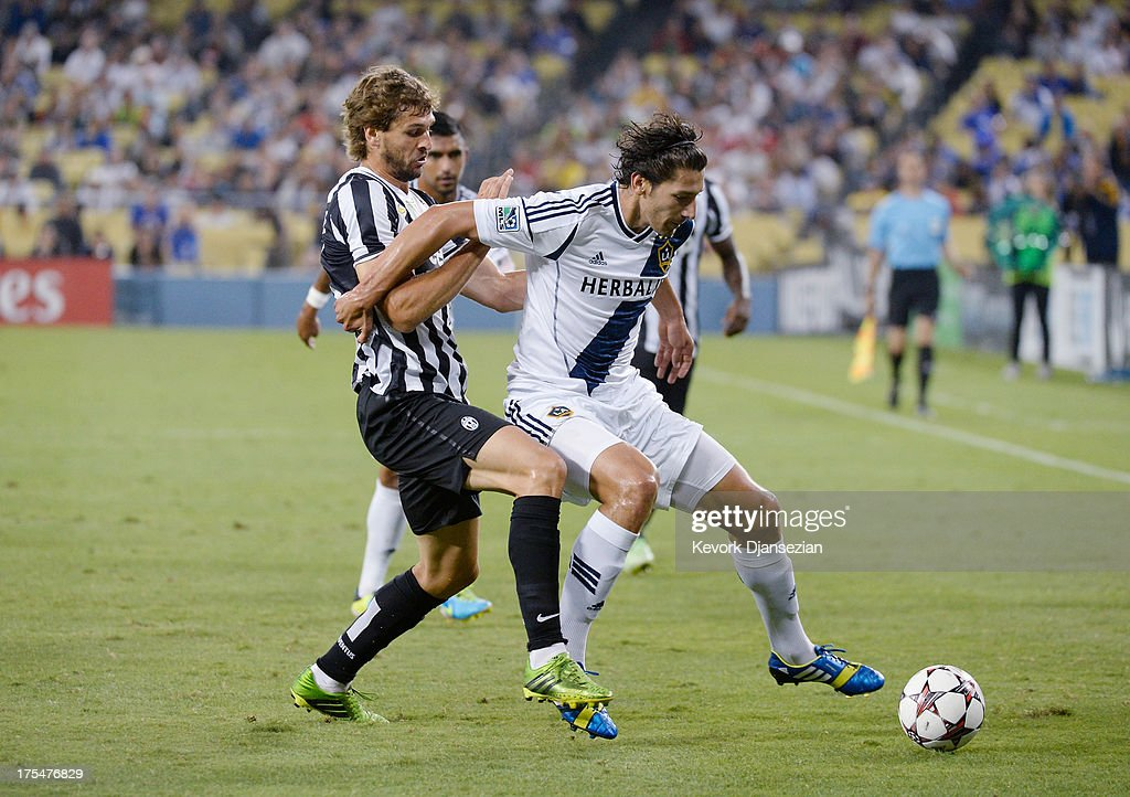 Defender Omar Gonzalez #4 of the Los Angeles Galaxy battles for the ball with Fernando Llorente #14 of Juventus during the second half of the 2013 Guinness International Champions Cup at Dodger Stadium on August 3, 2013 in Los Angeles, California