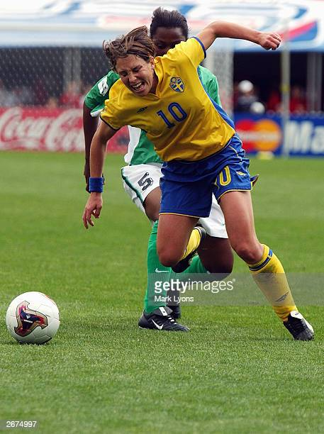 Defender Onome Ebi of Nigeria pressures forward Hanna Ljungberg of Sweden during the 2003 FIFA Women's World Cup at Crew Stadium on September 28 2003...