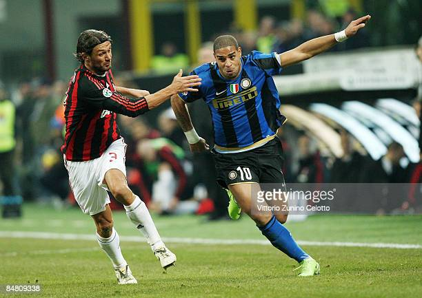 Defender Paolo Malfini of AC Milan and Forward Adriano of FC Inter in action during FC Inter Milan v AC Milan Serie A match on February 15 2009 in...