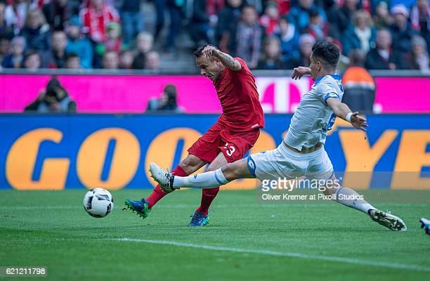 Defender Rafinha of Bayern Muenchen and Defender Benjamin Huebner of 1899 Hoffenheim during the 1 Bundesliga match between FC Bayern Muenchen and TSG...