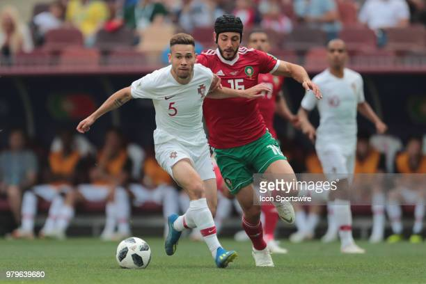 defender Raphael Guerreiro of Portugal and midfielder Noureddine Amrabat of Morocco during a Group B 2018 FIFA World Cup soccer match between...