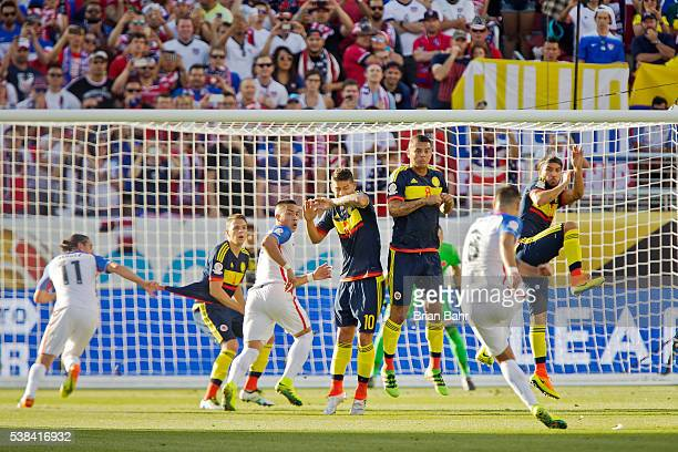 Defender Santiago Arias midfielder James Rodriguez midfielder Edwin Cardona and midfielder Sebastian Perez of Colombia defend against a kick by...