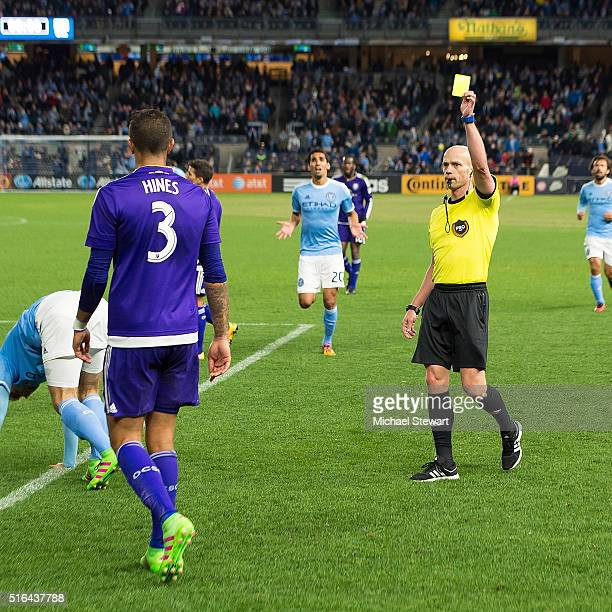 Defender Seb Hines of Orlando City SC receives a yellow card during the Orlando City SC vs New York City FC match at Yankee Stadium on March 18, 2016...