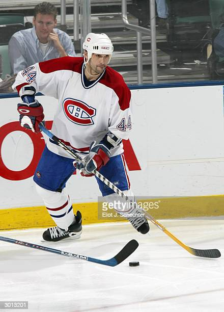 Defender Sheldon Souray of the Montreal Canadiens controls the puck against the Florida Panthers during the game at the Office Depot Center on...