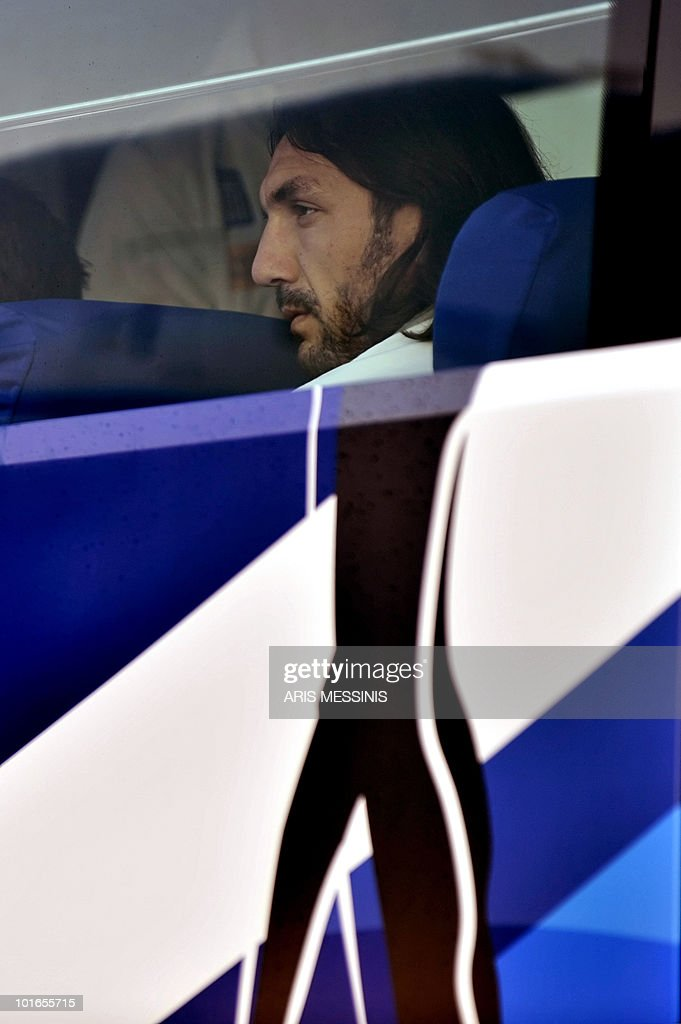 Defender Sotiris Kyriakos looks out from the bus window after Greece's national football team arrived at the King Shaka international airport in Durban on June 6, 2010 four days before the opening of the 2010 World Cup football tournament. The World Cup will take place in South Africa from June 11 to July 11, the first time on African soil for the biggest and most prestigious competition in sport. AFP PHOTO / Aris Messinis