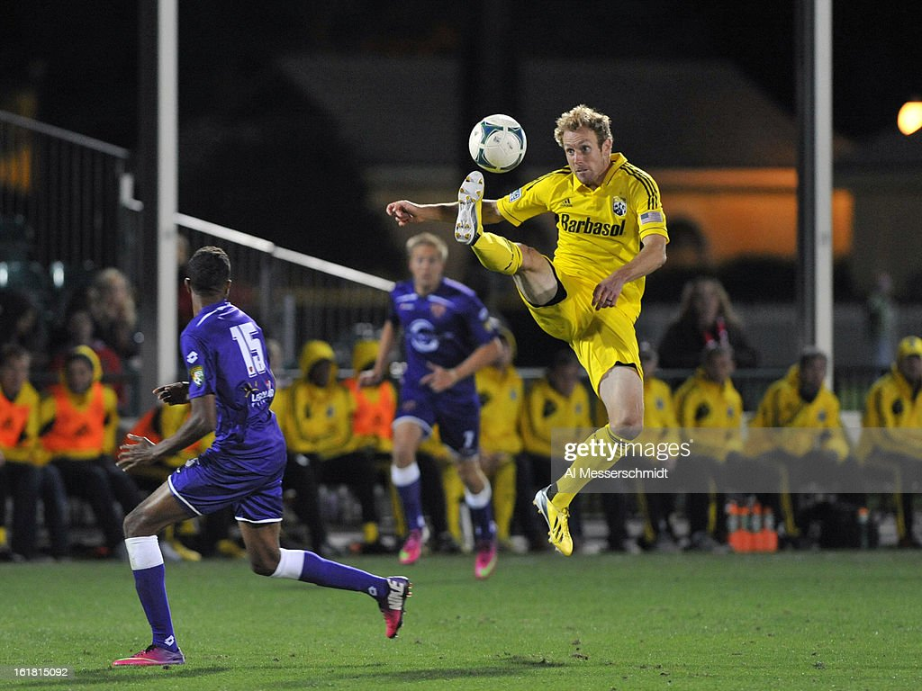 Defender Tyson Wahl #2 of the Columbus Crew jumps for a kick against Orlando City in the third round of the Disney Pro Soccer Classic at ESPN Wide World of Sports Complex on February 16, 2013 in Orlando, Florida.
