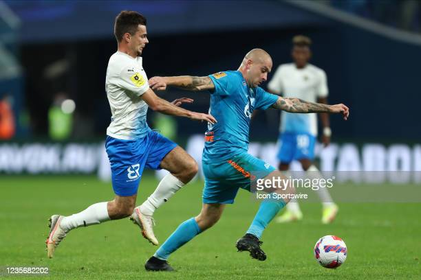 Defender Yaroslav Rakitskyi of FC Zenit and midfielder Artur Yusupov of FC Sochi vie for the ball during Russian Premier League match FC Sochi v FC...