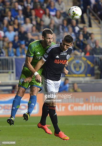 Defender Zach Scott of the Seattle Sounders FC and forward Sebastien Le Toux of the Philadelphia Union head the ball during the 2014 US Open Cup...