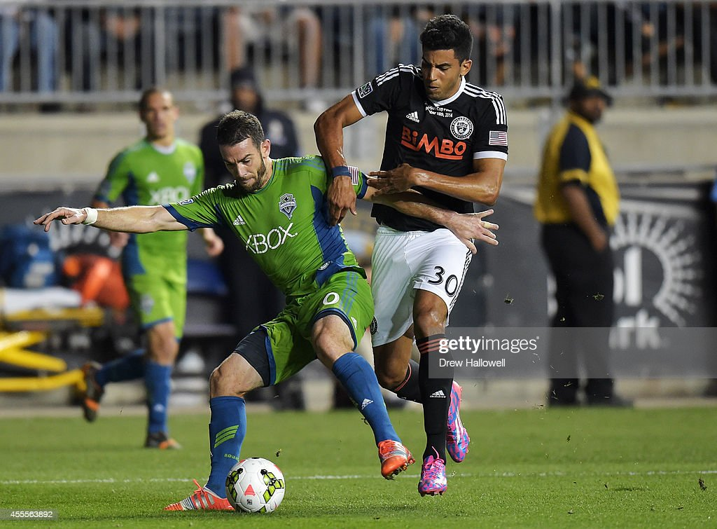 Defender Zach Scott #20 of the Seattle Sounders FC and Pedro Ribeiro #30 of the Philadelphia Union fight for the ball during the 2014 U.S. Open Cup Final at PPL Park on September 16, 2014 in Chester, Pennsylvania. The Sounders won 3-1.