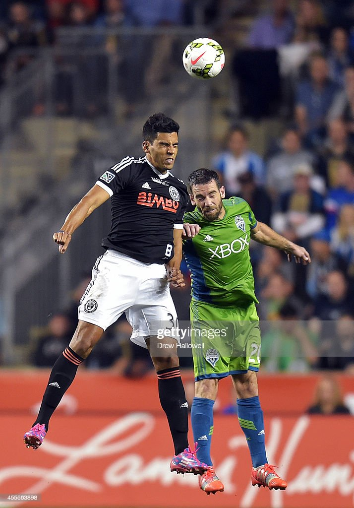 Defender Zach Scott #20 of the Seattle Sounders FC and Pedro Ribeiro #30 of the Philadelphia Union head the ball during the 2014 U.S. Open Cup Final at PPL Park on September 16, 2014 in Chester, Pennsylvania. The Sounders won 3-1.