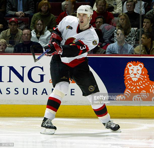 Defender Zdeno Chara of the Ottawa Senators passes the puck during the game against the Montreal Canadiens at the Bell Centre on February 24 2004 in...