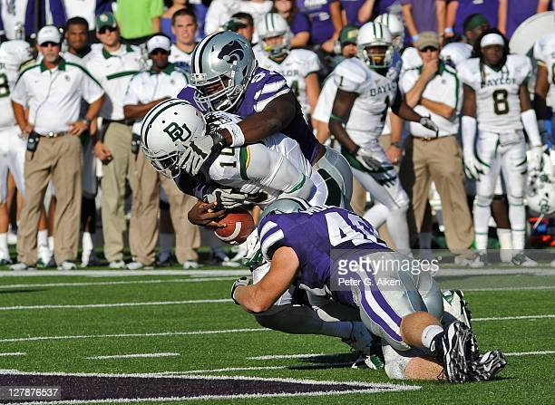 Defenders Adam Davis and Ryan Mueller of the Kansas State Wildcats sack quarterback Robert Griffin III of the Baylor Bears during a game on October 1...