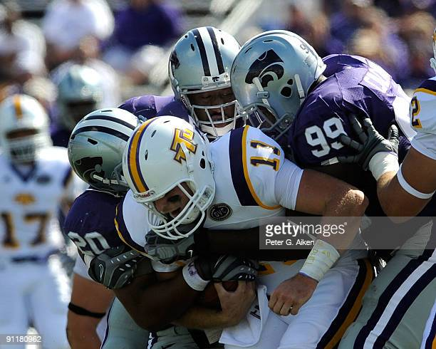 Defenders Daniel Calvin and Courtney Herndon of the Kansas State Wildcats sack quarterback Lee Sweeney of the Tennessee Tech Golden Eagles during the...