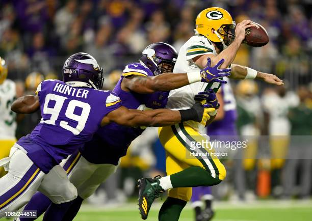 Defenders Danielle Hunter and Tom Johnson of the Minnesota Vikings combine to sack Aaron Rodgers of the Green Bay Packers in the second quarter of...