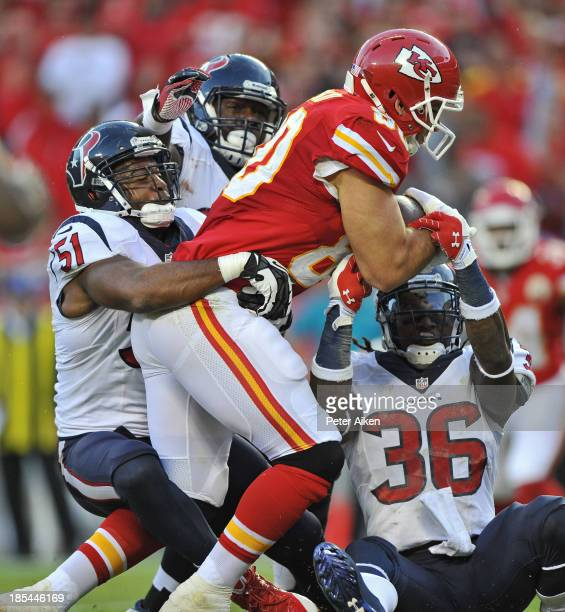 Defenders Darryl Sharpton and DJ Swearinger of the Houston Texans wrap up tight end Anthony Fasano of the Kansas City Chiefs short of the goal line...
