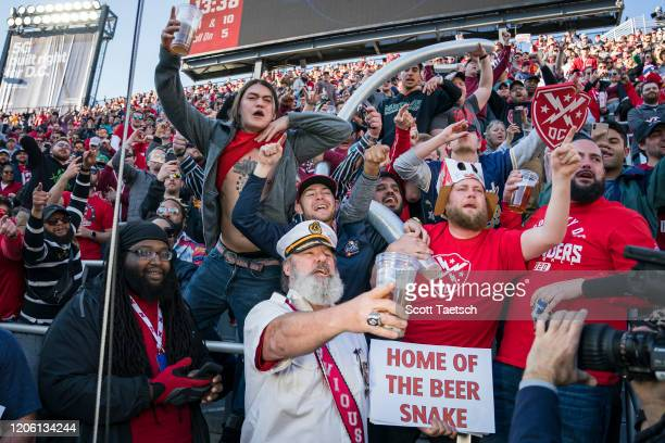 Defenders fans cheer as they form a beer cup snake during the second half of the XFL game between the DC Defenders and the St. Louis Battlehawks at...