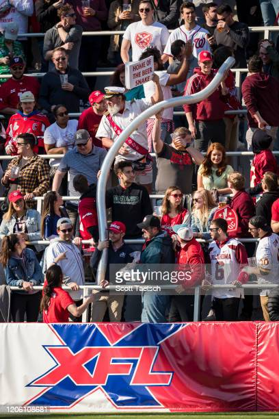 Defenders fans form a beer cup snake during the first half of the XFL game between the DC Defenders and the St. Louis Battlehawks at Audi Field on...