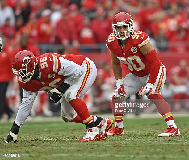 Defenders Josh Mauga and Jaye Howard of the Kansas City Chiefs get set on defense against the Oakland Raiders during the first half on December 14...