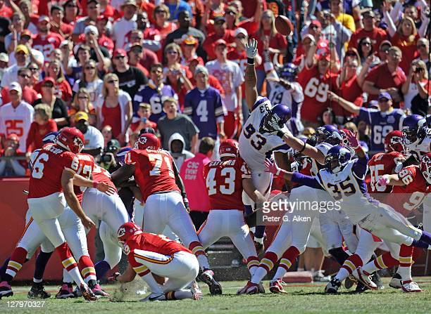 Defenders Kevin Williams and Marcus Sherels of the Minnesota Vikings attempt to block the field goal try of place kicker Ryan Succop of the Kansas...