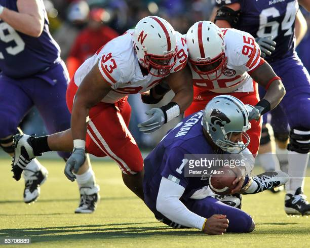 Defenders Ndamukong Suh and Pierre Allen of the Nebraska Cornhuskers sack quarterback Josh Freeman of the Kansas State Wildcats during the second...