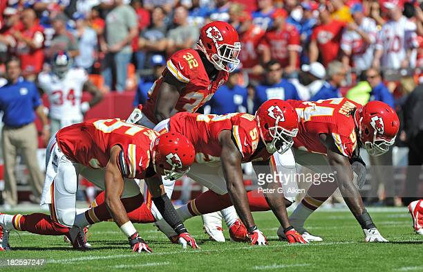 Defenders Quintin Demps JamesMichael Johnson Dezman Moses and Cyrus Gray of the Kansas City Chiefs gets set on a punt rush against the New York...