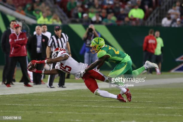 Defenders Rashad Ross makes a diving catch well being covered by Tampa Bay Vipers cornerback Anthoula Kelly during the XFL game between the DC...