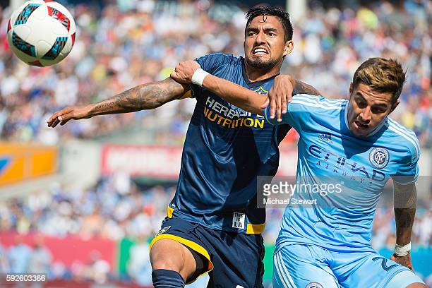 Defenders Ronald Matarrita of New York City FC and A J DeLaGarza of Los Angeles Galaxy vie for the ball during the match at Yankee Stadium on August...