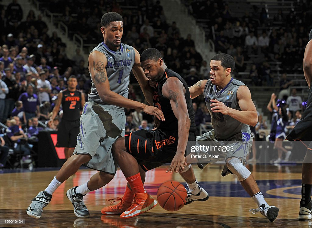 Defenders Shane Southwell #1 and Angel Rodriguez #13 of the Kansas State Wildcats pressure guard Marcus Smart #33 of the Oklahoma State Cowboys during the second half on January 5, 2013 at Bramlage Coliseum in Manhattan, Kansas. Kansas State defeated Oklahoma State 73-67.