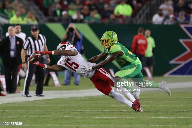 Defenders WR Rashad Ross makes a diving catch well being covered by Tampa Bay Vipers cornerback Anthoula Kelly during the XFL game between the DC...