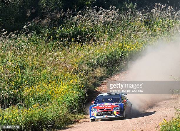 Defending and sixtime world champion Sebastien Loeb of France drives his Citroen C4 WRC with Daniel Elena of Monaco during the 19th special stage...