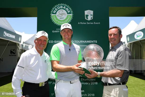 Defending champion Alex Noren of Sweden returns the trophy to Tournament Director David Williams and Tournament host Gary Player ahead of the 2017...