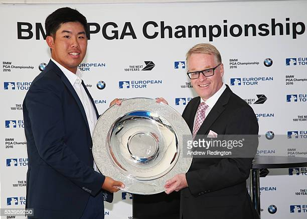 Defending Champion Byeong Hun An of South Korea receives the Sir Henry Cotton Rookie of the Year award from The European Tour Chief Executive Keith...