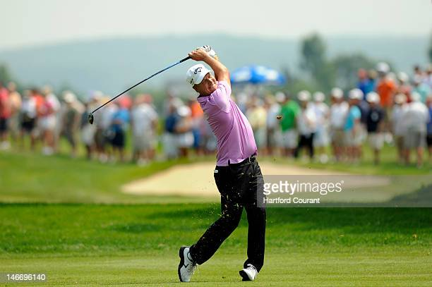 Defending champion Fredrik Jacobson drives on the sixth fairway during the second round of the Travelers Championship at the TPC at River Highlands...