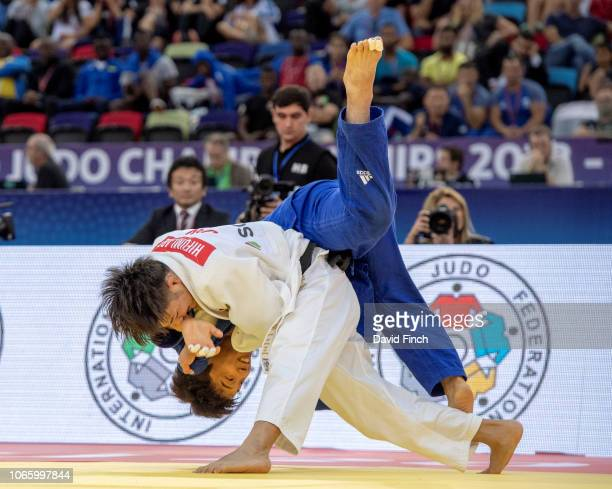 Defending champion Hifumi Abe of Japan throws 2015 World champion Baul An of South Korea for a wazari in extratime to reach the u66kg final during...