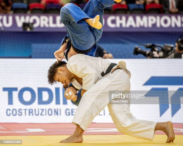 Defending champion Hifumi Abe of Japan throws Denis Vieru of Moldova for a wazari to win their u66kg round four contest during day two of the 2018...