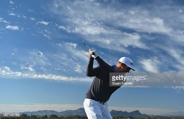 Defending champion Hunter Mahan of USA plays a shot during practice prior to the start of the World Golf ChampionshipsAccenture Match Play...
