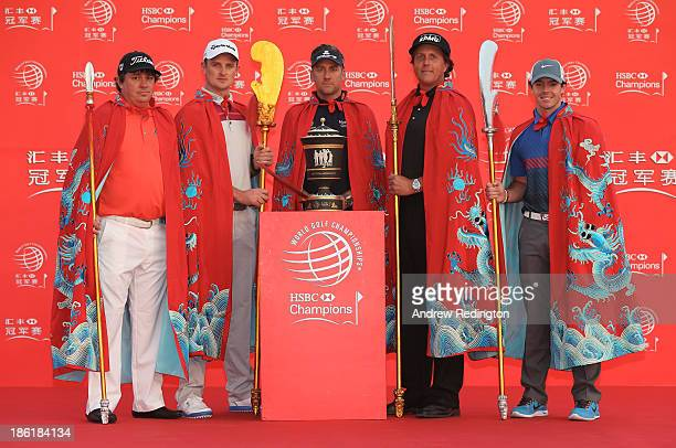 Defending champion Ian Poulter of England poses on stage with Jason Dufner of the USA, Justin Rose of England, Phil Mickelson of the USA and Rory...