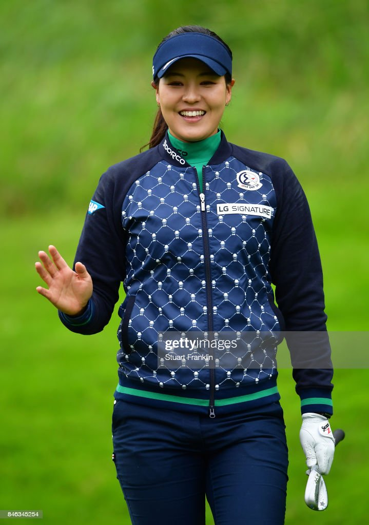 Defending Champion In Gee Chun of South Korea waves during the pro - am prior to the start of The Evian Championship at Evian Resort Golf Club on September 13, 2017 in Evian-les-Bains, France.