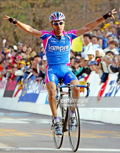 Defending champion Italy's Sergio Barbero of Lampre celebrates after winning the Japan Cup cycle road race in Utsunomiya, 100km north of Tokyo, 26...