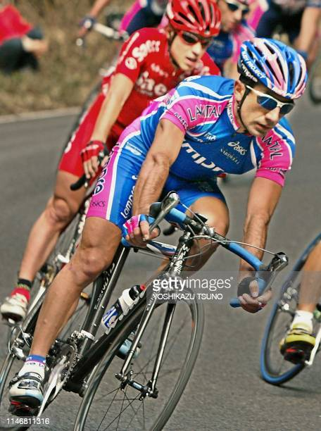 Defending champion Italy's Sergio Barbero of Lampre speeds on a downhill en route to win the Japan Cup cycle road race in Utsunomiya, 100km north of...