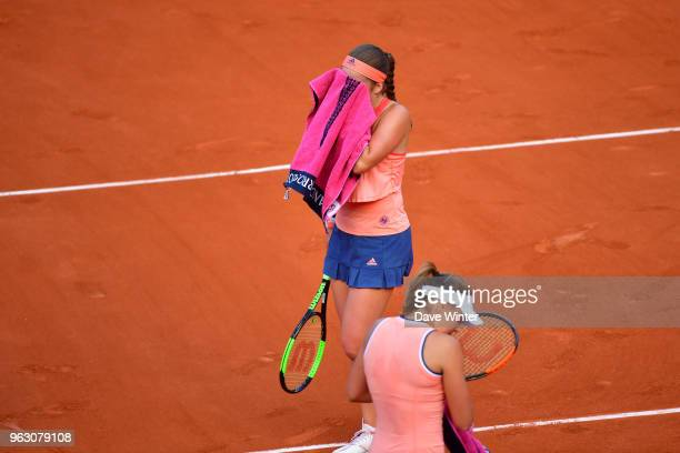 Defending champion Jelena Ostapenko of Latvia loses to Kateryna Kozlova of Ukraine during Day 1 of the the French Open at Roland Garros on May 27...