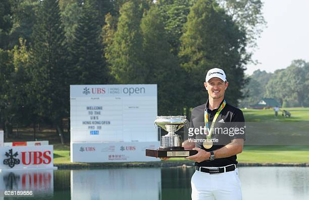 Defending champion, Justin Rose of England poses with the UBS Hong Kong Open trophy and his Olympic gold medal ahead of the UBS Hong Kong Open at The...