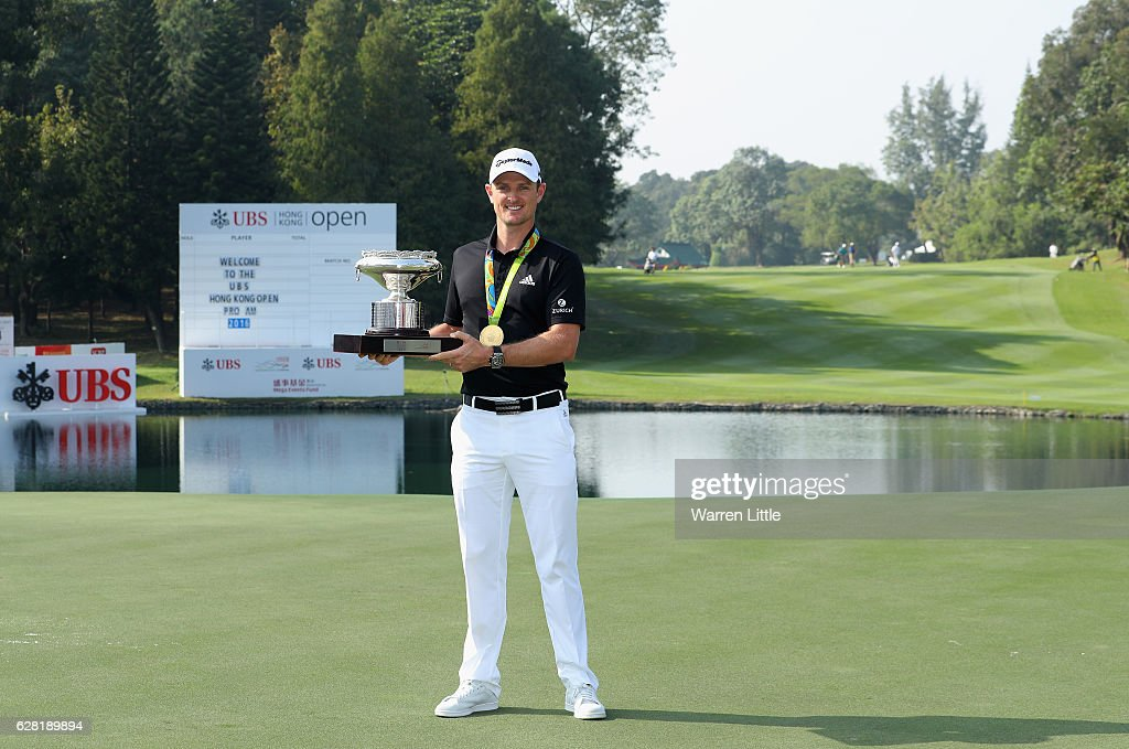 Defending champion, Justin Rose of England poses with the UBS Hong Kong Open trophy and his Olympic gold medal ahead of the UBS Hong Kong Open at The Hong Kong Golf Club on December 7, 2016 in Hong Kong, Hong Kong.